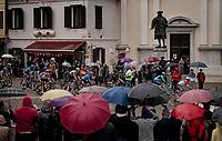 peloton crossing the town of Cormons in the rain<br /> <br /> 104th Giro d'Italia 2021 (2.UWT)<br /> Stage 15 from Grado to Gorizia (147km)<br /> <br /> ©kramon