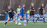 Boston Breakers forward Lauren Cheney (8) dribbles as Western New York Flash midfielder Brittany Bock (21) defends. In a Women's Professional Soccer (WPS) match, the Western New York Flash defeated the Boston Breakers, 2-1, at Harvard Stadium on April 17, 2011.