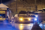 © Joel Goodman - 07973 332324 . 03/01/2017. Huddersfield, UK. Forensic officers at the scene of a bullet riddled white Audi car at the slip road at Junction 24 of the M62 motorway in Huddersfield . West Yorkshire police have announced a man has died following the discharge of a police firearm , during what they describe as a pre-planned operation , yesterday evening (2nd January 2017) . Photo credit : Joel Goodman