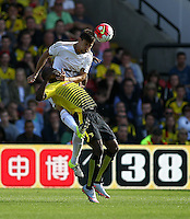 Federico Fernandez of Swansea battles with Odion Ighalo of Watford   during the Barclays Premier League match Watford and Swansea   played at Vicarage Road Stadium , Watford