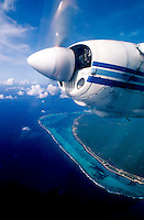 24 May 1983: View out of the cockpit window of a twin-engine Cessna, flying over the east end reefs of Grand Cayman Island, towards Little Cayman Island. Chartered flight for Scuba diving day trip, piloted by Glen Galtere. Diving through Pirate's Point...Mandatory Photo Credit: Ed Wolfstein Photo