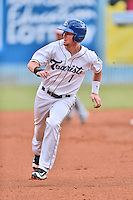 Asheville Tourists second baseman Brendan Rodgers (1) runs to third during a game against the Hagerstown Suns at McCormick Field on June 6, 2016 in Asheville, North Carolina. The Tourists defeated the Suns 12-10. (Tony Farlow/Four Seam Images)