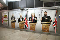 Caricature of Dominic Cummings, Prime Minister Boris Johnson, US President Donald Trump and Kanye West on large advertisement board for satirical television puppet show Spitting Image inside Westminster Tube Station. London September 30th 2020<br /> <br /> Photo by Keith Mayhew