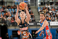 6th June 2021; Ken Rosewall Arena, Sydney, New South Wales, Australia; Australian Suncorp Super Netball, New South Wales, NSW Swifts versus Giants Netball; Jamie-Lee Price of the Giants Netball catches the ball under pressure from Maddy Proud of NSW Swifts
