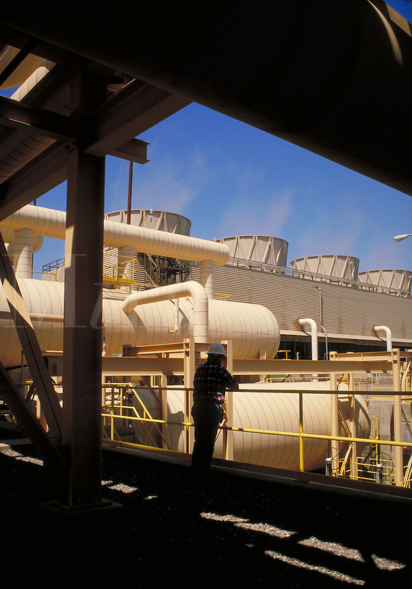 electrical plant technician overlooking geothermal power plant operations. technician.
