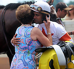June 28, 2014:  Two year old colt Cinco Charlie (Indian Charlie x Ten Halos, by Marquetry) wins the G3 Bashford Manor Stakes at Churchill Downs with jockey Shaun Bridgmohan.  Owner Corinne Heiligbrodt gives jockey Shaun Bridgmohan a hug in the winner's circle. Trainer Steve Asmussen, owners Corinne and L. William Heiligbrodt. Breeder Candyland Farm.  ©Mary M. Meek/ESW/CSM