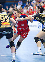 30 MAY 2012 - LONDON, GBR - Ewa Palies (GBR) of Great Britain (centre, in red and blue) looks for a way through the Montenegro defence during the women's 2012 European Handball Championship qualification match at the National Sports Centre in Crystal Palace, Great Britain (PHOTO (C) 2012 NIGEL FARROW)