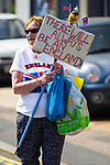 """© Joel Goodman - 07973 332324 . 24/04/2011 . Brighton , UK . A woman carries a placard reading """" There will always be an England """" . Nationalist street movement March for England holds a march and rally in Brighton , opposed by antifascists . Photo credit : Joel Goodman"""