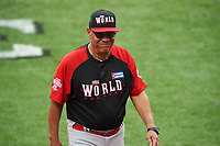 World Team manager Tony Perez (24) walks back to the dugout after a mound meeting during the MLB All-Star Futures Game on July 12, 2015 at Great American Ball Park in Cincinnati, Ohio.  (Mike Janes/Four Seam Images)