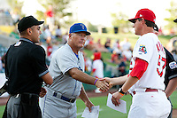 Manager Duane Espy (52) of the Tulsa Drillers shakes hands with Cardinals Manager Ron Warner (57) prior to a game against the Springfield Cardinals at Hammons Field on July 18, 2011 in Springfield, Missouri. Tulsa defeated Springfield 13-8. (David Welker / Four Seam Images)