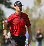 Davis Love III waves to the crowd after making his putt on the 9th hole during Turning Stone Resort Championship at Atunyote Golf Course in Verona, NY.