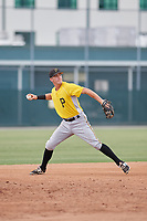 Pittsburgh Pirates Kyle Watson (25) throws to first base during an Instructional League intrasquad black and gold game on October 6, 2017 at Pirate City in Bradenton, Florida.  (Mike Janes/Four Seam Images)