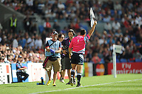 A medic and a touch judge share a lighter moment during Match 6 of the Rugby World Cup 2015 between Samoa and USA - 20/09/2015 - Brighton Community Stadium, Brighton <br /> Mandatory Credit: Rob Munro/Stewart Communications