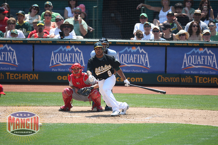 OAKLAND, CA - JULY 13:  Emil Brown of the Oakland Athletics bats during the game against the Los Angeles Angels of Anaheim at the McAfee Coliseum in Oakland, California on July 13, 2008.  The Angels defeated the Athletics 4-3.  Photo by Brad Mangin