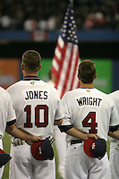 March 7, 2009:  Chipper Jones and David Wright of Team USA stand for the national anthem during the first round of the World Baseball Classic at the Rogers Centre in Toronto, Ontario, Canada.  Team USA defeated Canada 6-5 in both teams opening game of the tournament.  Photo by:  Mike Janes/Four Seam Images