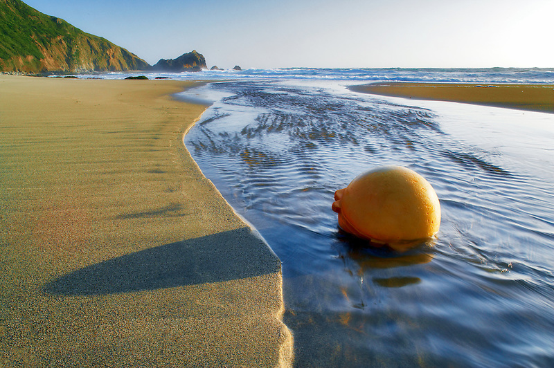 Fishing float ball on beach in stream. Point Reyes National Seashore. California