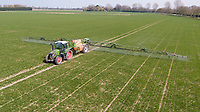 Spaying wheat with fungacide in early spring - Lincolnshire, April