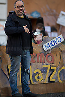 """Christian Raimo (Author, translator, teacher, journalist, co-founder & coordinator of litterary blog Minima&moralia, Municipio Roma III Councilor for Culture).<br /> <br /> Rome, 03/12/2020. Today, the Nuovo Cinema Palazzo Community held a second public assembly (1.) in Rome's San Lorenzo district to protest against the eviction of the """"Nuovo Cinema Palazzo"""" completed by the Italian police forces in the early morning of the 25th of November and to demonstrate against the violent reaction of the Police forces when, in the evening of the same day, a large demo asked to have the chance to hold a public assembly in the square (Piazza dei Sanniti) of the cinema (2.). The public assembly of today saw the participation and the support & solidarity of the representatives of movements, actors, musicians, students, artists, politicians, and citizens of San Lorenzo who told their stories and memories related to the famous Rome's Art and culture occupation (For example, actor Marcello Fonte, Best Actor Award of the 2018 Cannes Film Festival for the film Dogman, was among the first group of occupiers of the Nuovo Cinema Palazzo). The assembly of the 1st December was interrupted due to the bad weather (3).<br /> The Nuovo Cinema Palazzo was occupied the 15th of April 2011, when citizens, movements, workers of the entertainment industry reopened the former """"Palazzo Cinema"""" to prevent the opening of a casino/gambling space. The illegal occupation was intended as a public hub of art, culture, sport and politics, an open place for exchange, discussion, studies, caring and sharing.<br /> <br /> Footnotes & Links:<br /> 1. http://bit.do/fLCpE<br /> 2. Demo And Clashes Against Nuovo Cinema Palazzo Eviction in Rome's San Lorenzo: http://bit.do/fLxgz<br /> 3. http://bit.do/fLCr3<br /> Previous Stories about Nuovo Cinema Palazzo: 14.04.2018 - Nuovo Cinema Palazzo's Concert: """"7 Anni di CasiNò 