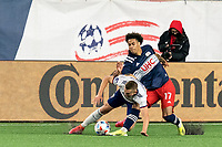 FOXBOROUGH, MA - APRIL 24: Russell Canouse #6 of D.C. United dribbles as Tajon Buchanan #17 of New England Revolution pressures during a game between D.C. United and New England Revolution at Gillette Stadium on April 24, 2021 in Foxborough, Massachusetts.