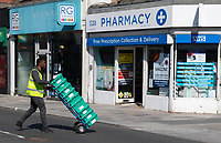 A delivery driver delivering to the Pharmacy in Sidcup, Kent during the Coronavirus (COVID-19) outbreak where travel has been restricted across the country at Sidcup, England on 25 March 2020. Photo by Alan Stanford/PRiME Media Images