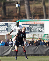 University of Connecticut forward Mamadou Doudou Diouf (23) and Northeastern University defender Jonathan Eckford (6) battle for head ball. .NCAA Tournament. University of Connecticut (white) defeated Northeastern University (black), 1-0, at Morrone Stadium at University of Connecticut on November 18, 2012.