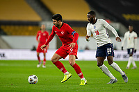 13th October 2020; Molineux Stadium, Wolverhampton, West Midlands, England; UEFA Under 21 European Championship Qualifiers, Group Three, England Under 21 versus Turkey Under 21; Guven Yalcin of Turkey with the ball at his feet as he comes under pressure from Josh Dasilva of England