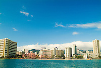 The famous coastline of Waikiki Beach shot from a sailboat.