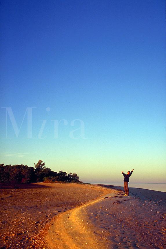 Joyful camper on Sand Key in the Ten Thousand Islands National Seashore along Florida's Gulf of Mexico coast.
