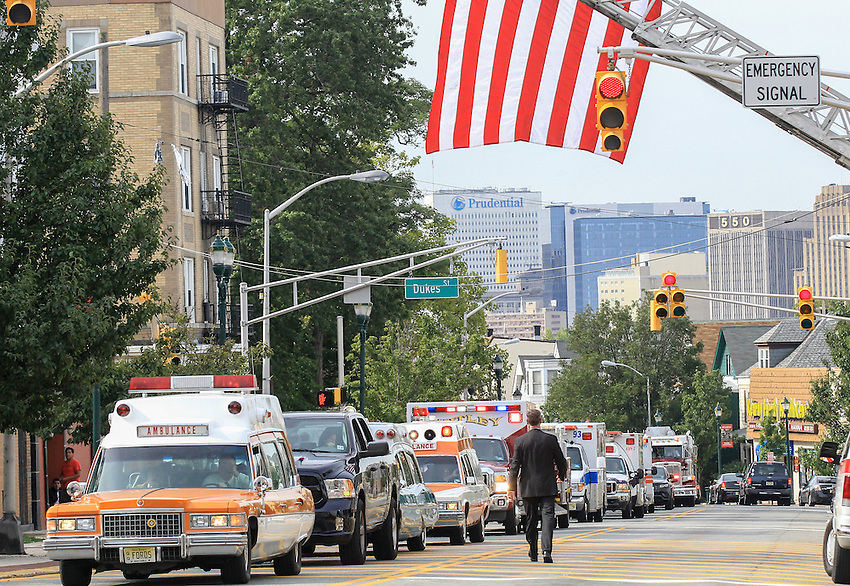 Ambulances and firefighting apparatus line Kearny Avenue outside St. Cecilia's Church in Kearny at the funeral for Manasquan volunteer firefighter Dan McCann. McCann, a firefighter EMT with more than 25 years experience, died last week after a fire department training exercise in Manasquan.  9/21/16  (Andrew Mills   NJ Advance Media for NJ.com)