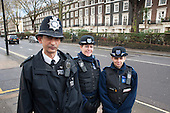 Metropolitan Police Constable with Community Support Officers, Sussex Gardens, Paddington.
