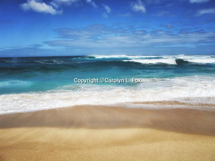Waves run up on the sand on Kauai, Hawaii.