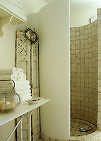 This shower enclosure with curved walls is a clever use of space in a small bathroom