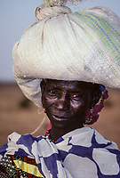 Woman with Bag of Market Purchases on Head, Boubon, near Niamey, Niger.