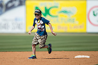 A young fan get the chance to run the bases following the South Atlantic League game between the Lakewood BlueClaws and the Kannapolis Intimidators at Kannapolis Intimidators Stadium on May 8, 2016 in Kannapolis, North Carolina.  The Intimidators defeated the BlueClaws 3-2.  (Brian Westerholt/Four Seam Images)