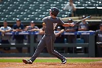 Kyle McCann (15) of the Georgia Tech Yellow Jackets follows through on his swing against the Miami Hurricanes during game one of the 2017 ACC Baseball Championship at Louisville Slugger Field on May 23, 2017 in Louisville, Kentucky. The Hurricanes walked-off the Yellow Jackets 6-5 in 13 innings. (Brian Westerholt/Four Seam Images)