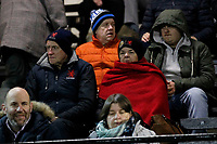 Fans wrap up warm during the Greene King IPA Championship match between London Scottish Football Club and Nottingham Rugby at Richmond Athletic Ground, Richmond, United Kingdom on 7 February 2020. Photo by Carlton Myrie.