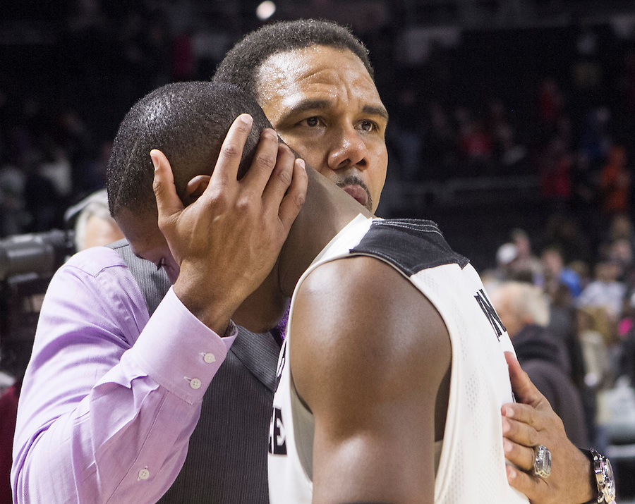 Mae Gammino/Friarbasketball.com<br /> Providence College basketball coach Ed Cooley, left, and Kris Dunn (3) share a moment post game on Saturday, January, 10, at the Providence Civic Center, after Providence College beat Georgetown 60-57, in overtime.  The teams meet again on February 2, at Georgetown.