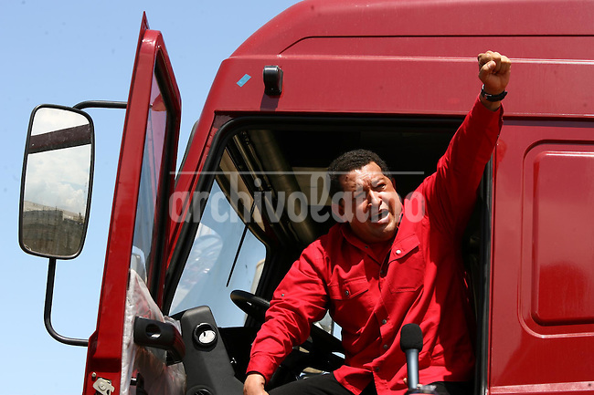 Venezuelan President Hugo Chavez greeted by workers during a visit to a petrochemical plant in Carabobo state