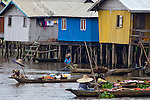 "Ganvie, Benin, with some 3,000 stilted buildings and a population of 20,000-30,000 people, may be the largest ""lake vllage"" in Africa.  In Ganvie, the population lives exclusively from fishing, building houses on stilts in and next to Lake Nokoue.  Because the Dan-Homey religion prohibited attacks on communities living in the water, the village of Ganvie dates back to the 16th or 17th century, when it was built to protect people from slavery.  Even Ganvie's fruit and vegetable market is on water!!!"