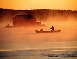 Paddling canoe in sunrise