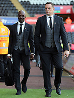 Swansea assistant coach Claude Makelele and goalkeeping coach Tony Roberts arrive prior to the game during the Premier League match between Swansea City and Brighton and Hove Albion at The Liberty Stadium, Swansea, Wales, UK. Saturday 04 November 2017
