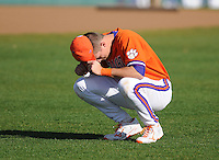 Third baseman Richie Shaffer (8) of the Clemson Tigers reflects before a game against the University of Alabama-Birmingham on Feb. 17, 2012, at Doug Kingsmore Stadium in Clemson, South Carolina. UAB won 2-1. (Tom Priddy/Four Seam Images)