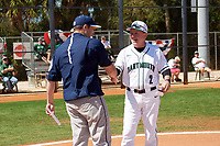 Dartmouth Big Green head coach Bob Whalen (2) shakes hands with Villanova Wildcats head coach Kevin Mulvey before a game on March 3, 2018 at North Charlotte Regional Park in Port Charlotte, Florida.  Dartmouth defeated Villanova 12-7.  (Mike Janes/Four Seam Images)