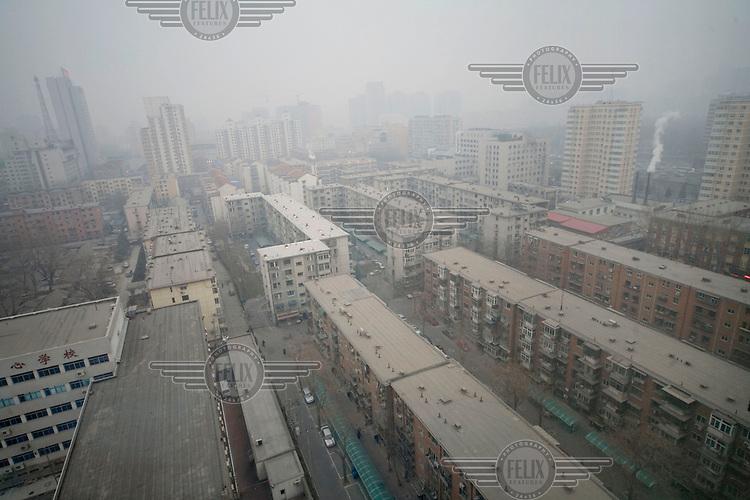 Smog over city centre apartment blocks.