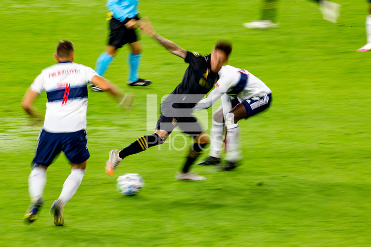 LOS ANGELES, CA - SEPTEMBER 23: Brian Rodriguez #17 of theLos Angeles football club moves with the ball during a game between Vancouver Whitecaps and Los Angeles FC at Banc of California Stadium on September 23, 2020 in Los Angeles, California.