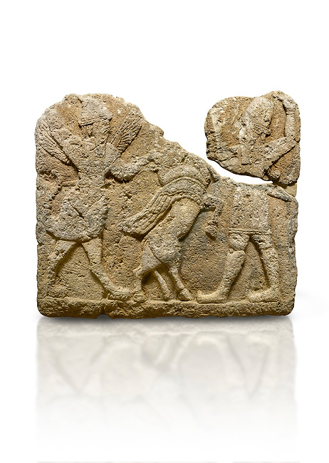 Picture & image of Hittite relief sculpted orthostat stone panel of Herald's Wall. Limestone, Karkamıs, (Kargamıs), Carchemish (Karkemish), 900-700 B.C. Anatolian Civilisations Museum, Ankara, Turkey.<br /> <br /> On the left is a winged mixed creature with a human head and body who has a scorpion tail and bird legs; on the right is a human-like god. The figures fight with a winged bull standing on its hind legs. The scorpion-man is known as Girtablull.<br /> <br /> Against a white background.