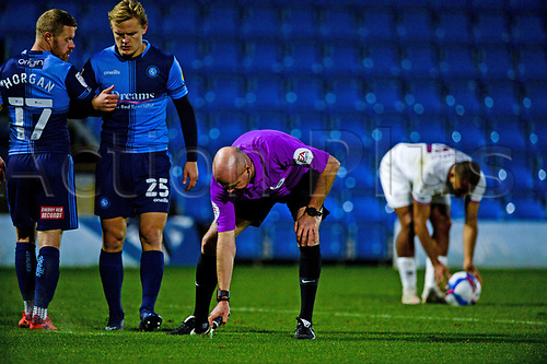 21st November 2020; Adams Park Stadium, Wycombe, Buckinghamshire, England; English Football League Championship Football, Wycombe Wanderers versus Brentford; Referee Lee Mason marks out 10 yards distance for a freekick.