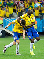 Oscar of Brazil celebrates scoring a goal with Ramires after making it 3-1