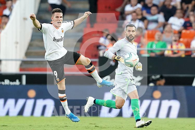 Valencia CF's Kevin Gameiro (l) and Real Sociedad's Miguel Angel Moya during La Liga match. August 17,2019. (ALTERPHOTOS/Acero)