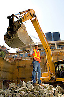 Portrait of a construction worker in front of a large earth mover at the Balfour Beatty Construction site at Bank of America in Charlotte, NC.